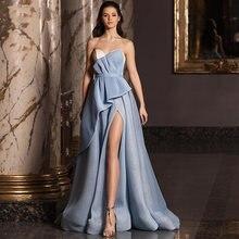 Блестящее вечернее платье с открытой спиной а силуэт