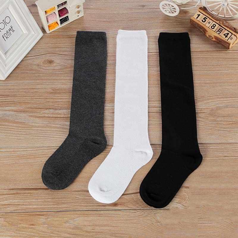 Calcetines de tubo largo hasta la rodilla para niños y niñas, calcetines blancos para uniforme escolar, calcetines Harajuku largos negros para estudiantes de 1 a 15 años