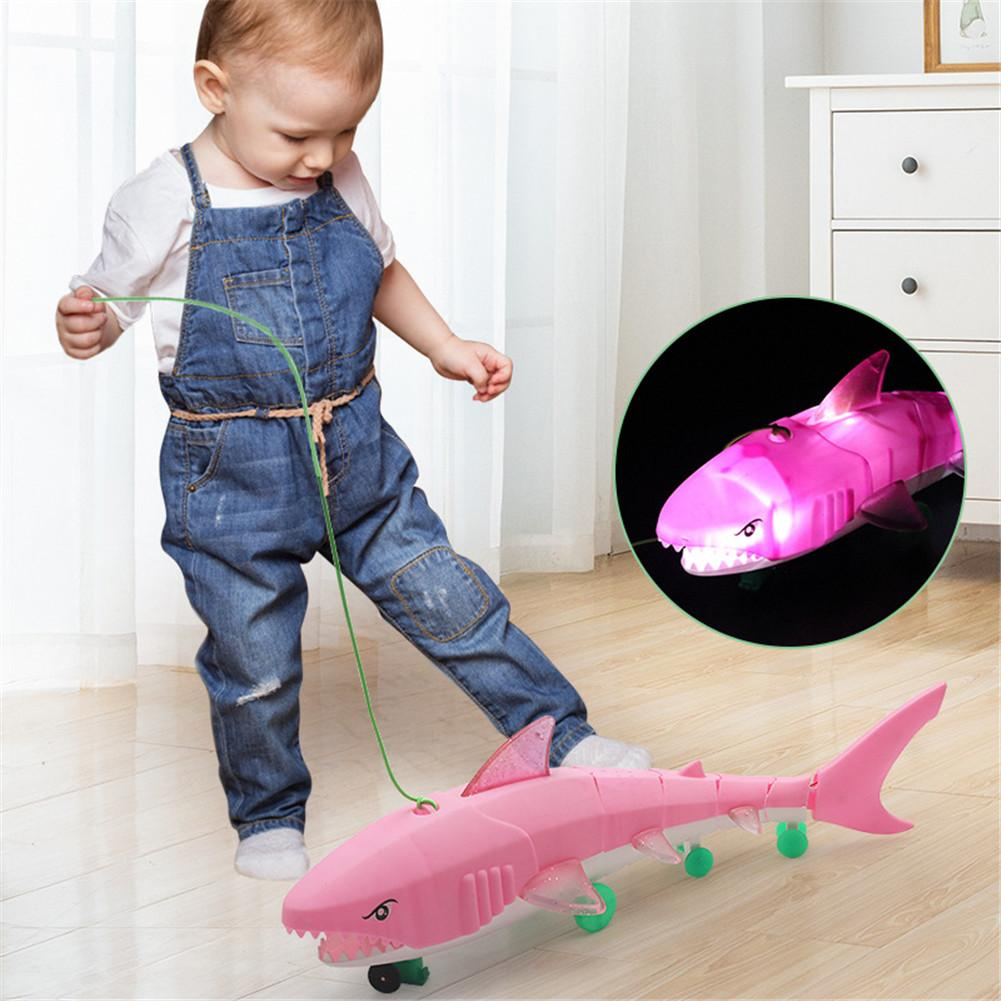 Funny Plastic Kid's Electric Toys Drawstring Electric Shark Leash Lighting Music Universal Shark Children's Toys With Led Light