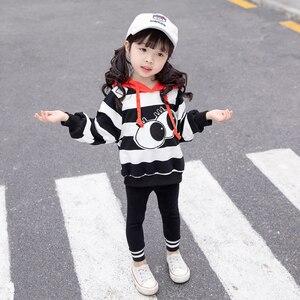 Ropa de manga larga para niños primavera otoño nuevo conjunto de suéter a rayas de ojos grandes conjunto de trajes de bebé para niñas conjunto de lindos trajes de bebé