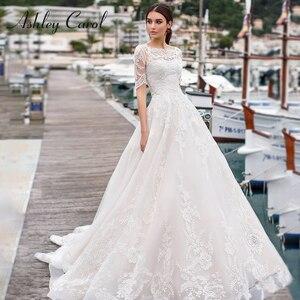 Image 1 - אשלי קרול קו שמלות כלה עם מעיל 2020 Vestido דה Noiva חוף חצי שרוול אפליקציות תחרה עד כפתור כלה שמלות