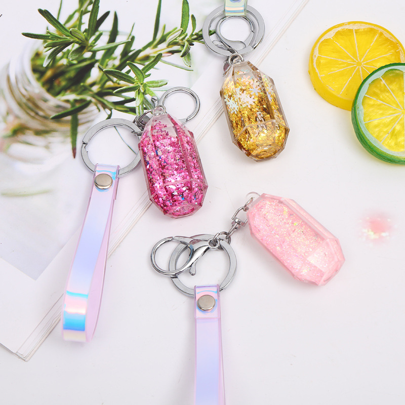 Cute Glitter Moving Liquid Keychains Women Quicksand Perfume Bottle Key Chain Car Radium Rope Pendant Lovely Bag Key Ring