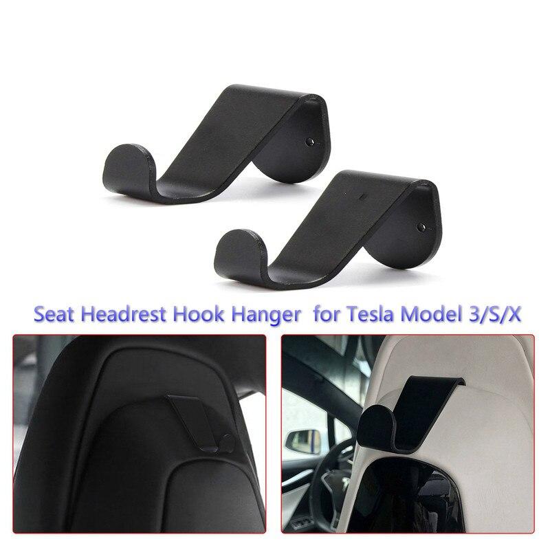 Genuine VW Front Seat Headrest Hooks Hangers black 2x pcs