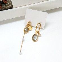 Earrings unique asymmetric crystal geometry tassel long temperament women small earrings stud