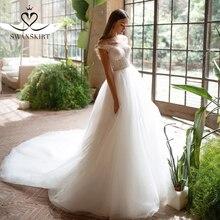 Peri boncuklu düğün elbisesi SWANSKIRT I227 kapalı omuz kristal kemer A Line Illusion tül prenses gelin kıyafeti Vestido de novia