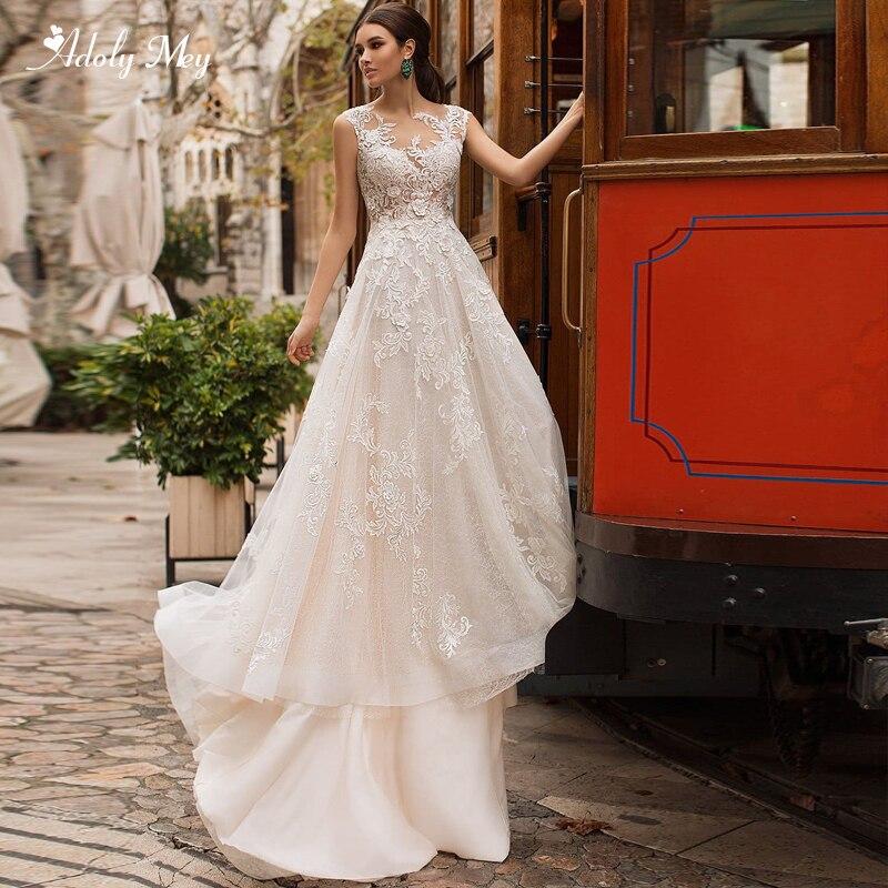 Adoly Mey Elegant Scoop Neck Button A-Line Wedding Dresses 2020 Court Train Applques Cap Sleeve Princess Wedding Gown Plus Size
