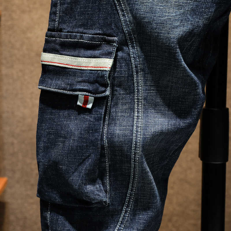 Kstun moda harém jeans homem streetwear azul estiramento haren calças bolsos laterais moto motociclista jeans demim solto pés calças corredores