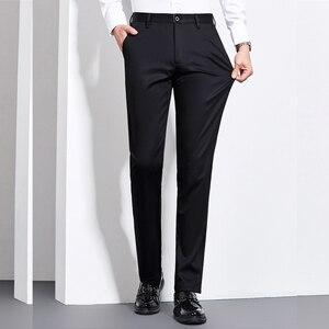 Image 4 - Мужские Теплые повседневные брюки, черные или темно синие Однотонные эластичные брюки в деловом стиле, новинка для зимы 2019