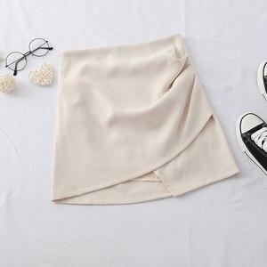 Image 4 - HELIAR jednolite, nieregularne spódnica Hem A Line Micro spódnica na plażę styl Preppy spódnica z plisowaną spódnica z wysokim stanem dla kobiet 2020 lato
