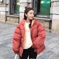 Frauen Winter Jacke Solide Stehkragen Tasche Baumwolle Lose Warme Kurze Parka Jacke Winter Padded Koreanische Weibliche Weiche Mantel