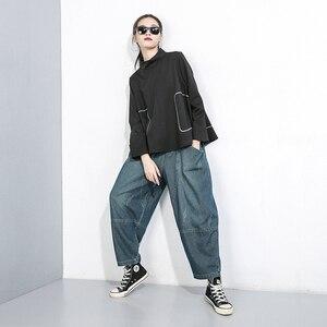 Image 3 - [Eam] alta elástico emendado bolso denim calças de cintura nova solto ajuste harem calças moda feminina maré primavera outono 2020 1b694