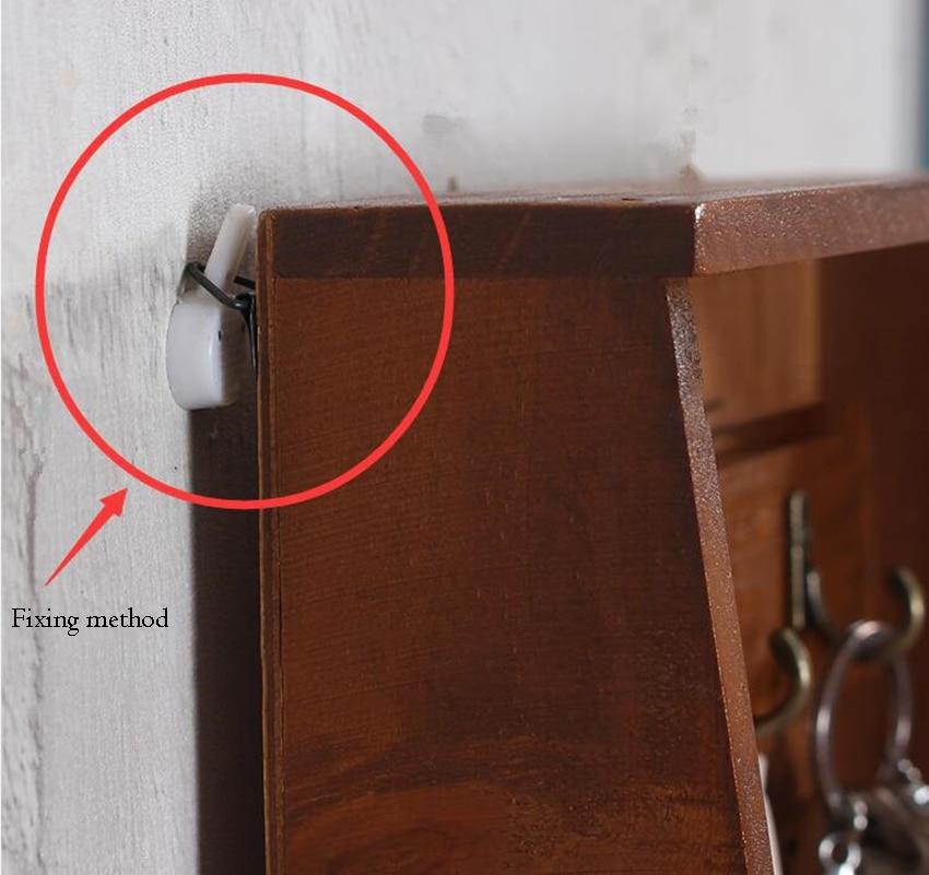 caixa segura chave de madeira montada na