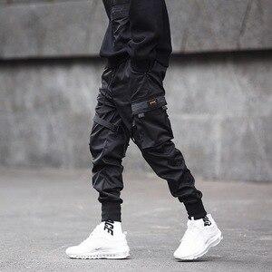 Image 2 - Hip Pop Cargo spodnie męskie z czarnymi kieszeniami Harem biegaczy Harajuku spodnie dresowe dorywczo mody męskie spodnie Streetwear spodnie dresowe Hombre