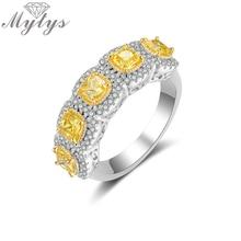 خاتم رومانسي على الموضة من Mytys خاتم رائع مكون من اللون الأصفر خاتم مكعبة الزركون AAA للنساء مجوهرات فاخرة مرصعة بالكامل R2149