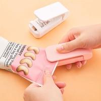 Tragbare Mini Sealer Home Wärme Tasche Kunststoff Lebensmittel Snacks Tasche Abdichtung Maschine Lebensmittel Verpackung Küche Lagerung Tasche Clips Großhandel