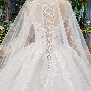 Image 4 - HTL954 ארוך שרוול שמלות כלה אשליה o צוואר חרוזים קריסטל סין כלה שמלות בטורקיה robe דה mariee 11.11 קידום