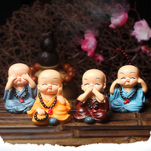 New creative car perfume small monk Shaking Head Car Ornaments doll cute decoration interior supplies
