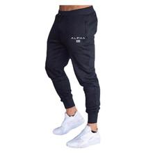 Spodnie sportowe męskie spodnie sportowe spodnie joggery męskie spodnie sportowe spodnie obcisłe spodnie dresowe męskie spodnie siłownia spodnie kulturystyczne tanie tanio GJKCN Poliester Sznurek Pełnej długości Bieganie Pasuje prawda na wymiar weź swój normalny rozmiar