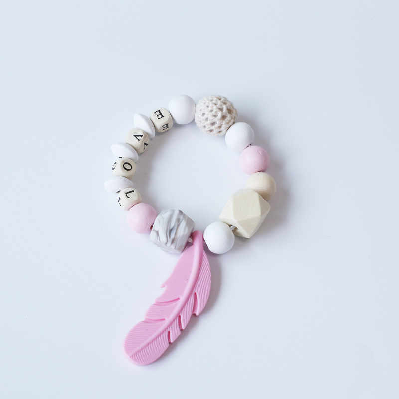Hot Selling Wooden Infant Bracelet Teether Color Beads Crochet Feather Bite Music Toy