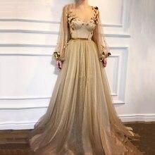 Вечернее платье цвета шампанского с длинными рукавами фонариками