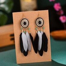 цена на Boho Black feather earring Bohemian vintage long Chain tassel beads Round Alloy earrings for women jewelry
