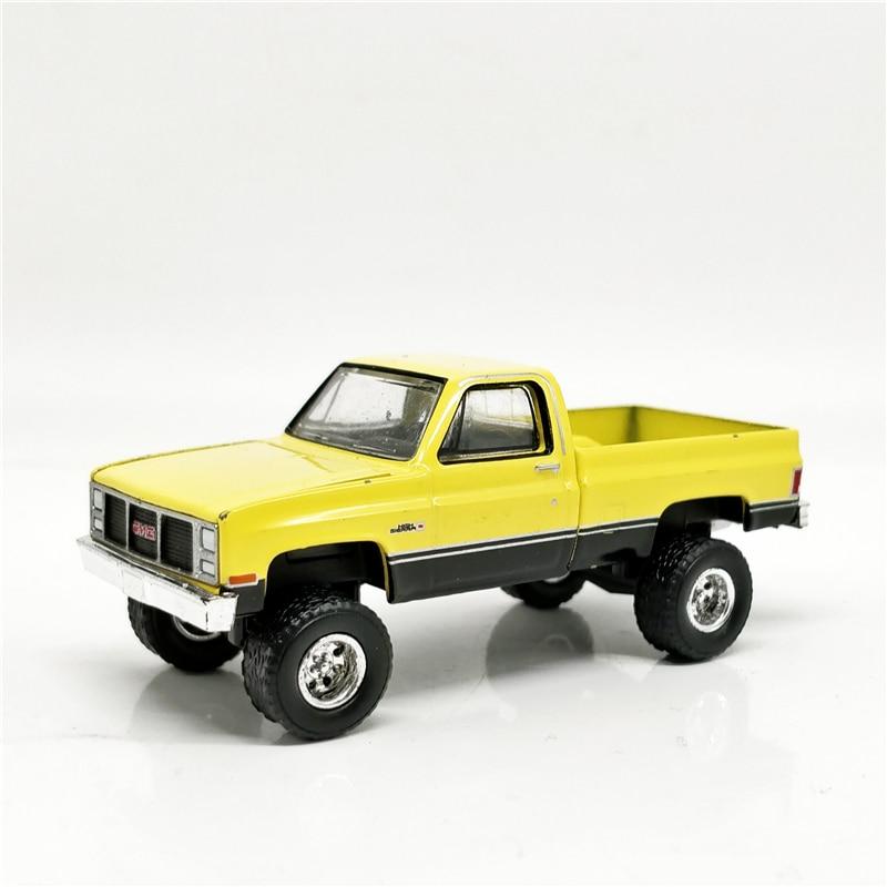Greenlight 1:64 All Terrain 1987 GMC High Sierra 2500 Yellow No Box