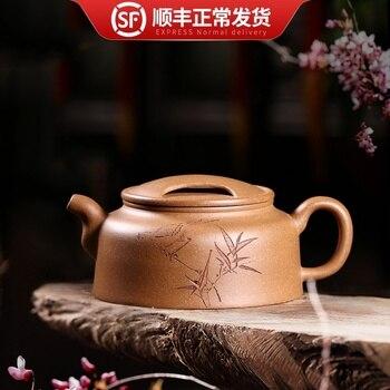 Yixing настоящий фиолетовый глиняный горшок-это небольшой чайник, сделанный вручную