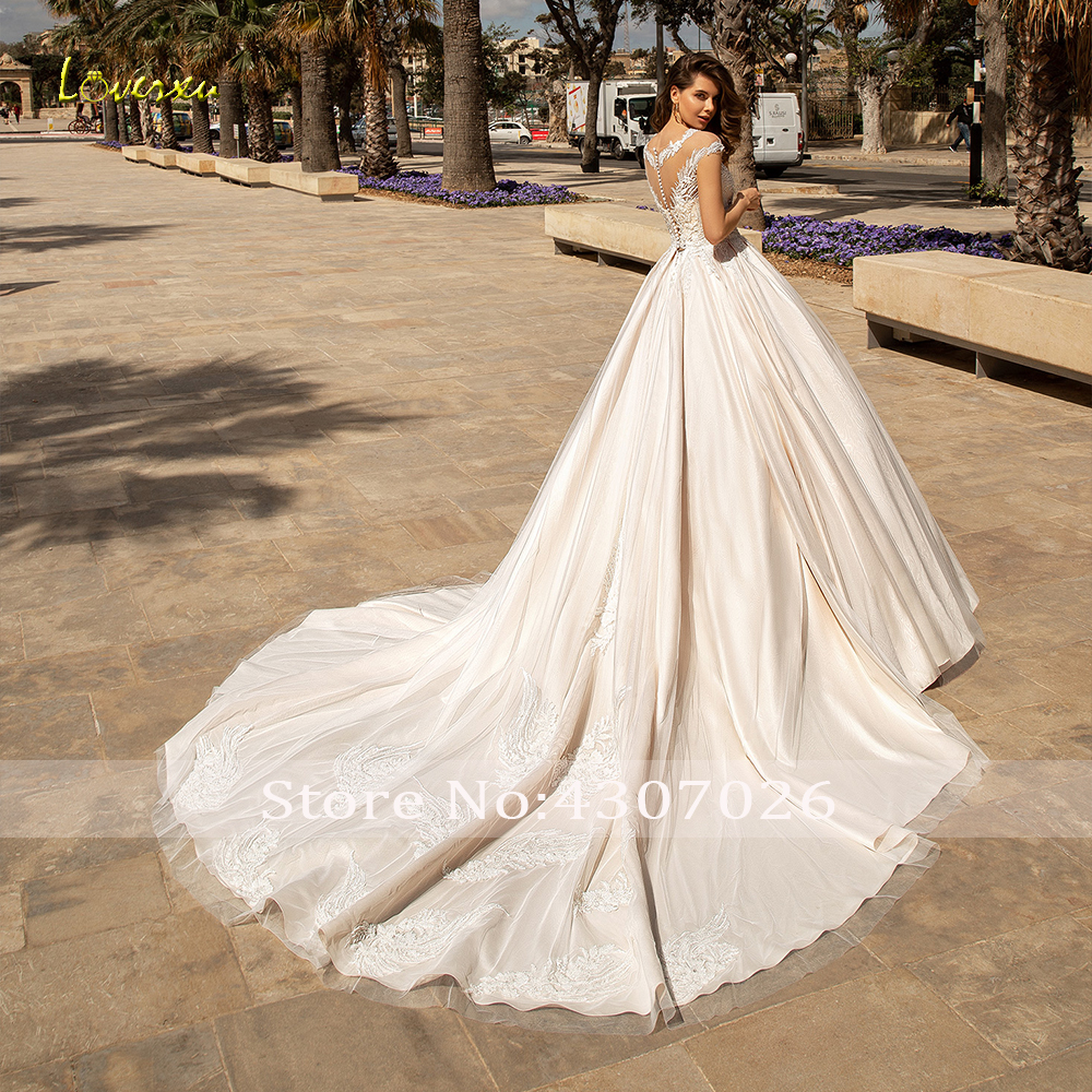 Image 2 - Loverxu Delicate O Neck Ball Gown Wedding Dresses Chic Applique Cap Sleeve Button Bride Dress Chapel Train Bridal Gown Plus Size-in Wedding Dresses from Weddings & Events