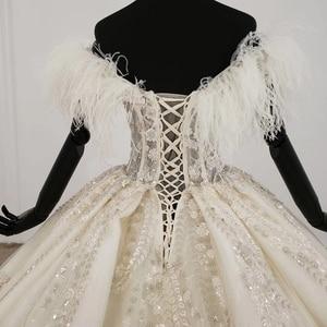 Image 5 - HTL1248 王女のウェディングドレス 2020 毛皮の襟縫製ビーズ上レーススカート背中自由奔放に生きるウェディングロングスリーブ vestido デ noiva