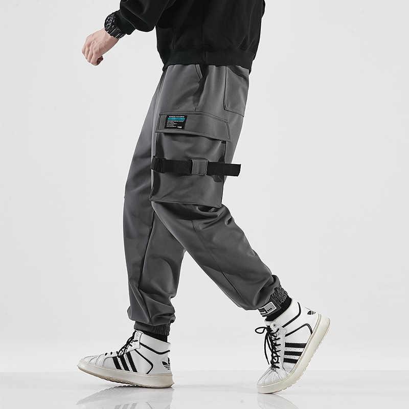 新しい秋弾性リボンマルチポケットハーレムパンツストリート全身日本スタイルのストリートカジュアルファッション男性ジョガー