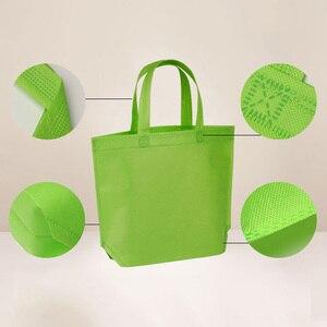Image 4 - 10PC wielofunkcyjny prezent duże torba z rączkami dzieci Birthday Party favor włókniny torby na prezent 7 jednolity kolor z uchwytem torba na zakupy DIY prezent torba