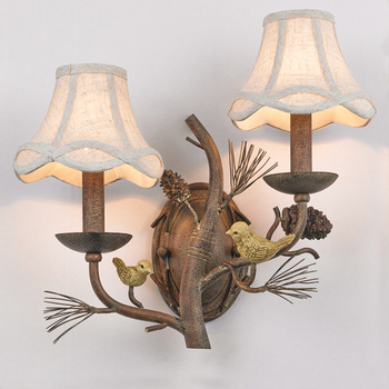A Pair Of Green Bird Statues Standing On A Pine Cone Tree Sconce Aisle Doorway Foyer Corridor Staircase Teahouse Bedside Light