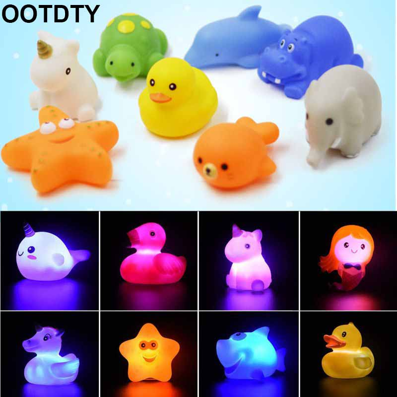 New Automatic Flash Light Water Light Up Glowing Dolphin Kids Bath Toys Soft
