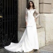 Romantyczne satynowe i koronkowe aplikacje długie rękawy suknie ślubne Sheer Scoop Ivory przyciski powrót ślub panny młodej suknie 2020 Vestidos
