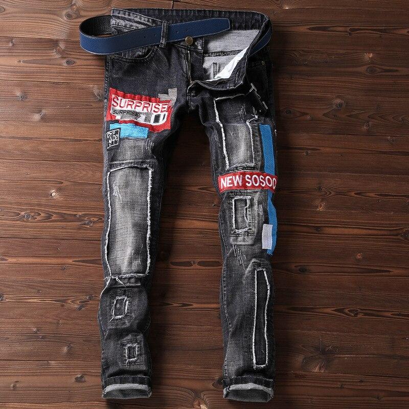Vêtements pour hommes nouvelle personnalité Jeans brodés mode Patch percé Locomotive Jean Streetwear style Hip Hop pantalon unique
