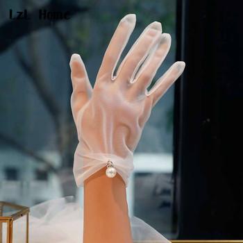 LzL strona główna rękawiczki ślubne rękawiczki ślubne białe półprzezroczyste rękawiczki damskie rękawiczki letnie damskie rękawiczki z palcami tanie i dobre opinie LzL Home Poliester Palec Jeden rozmiar Nadgarstek WOMEN Dla dorosłych Zroszony Apartament dla nowożeńców rękawice 30064