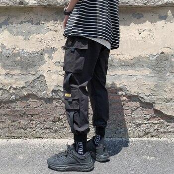 цена на Men Fashion Sporty Pants For Hip hop safari style Causal Runnings Pants High Street Jogger Pants New Pocket Trousers