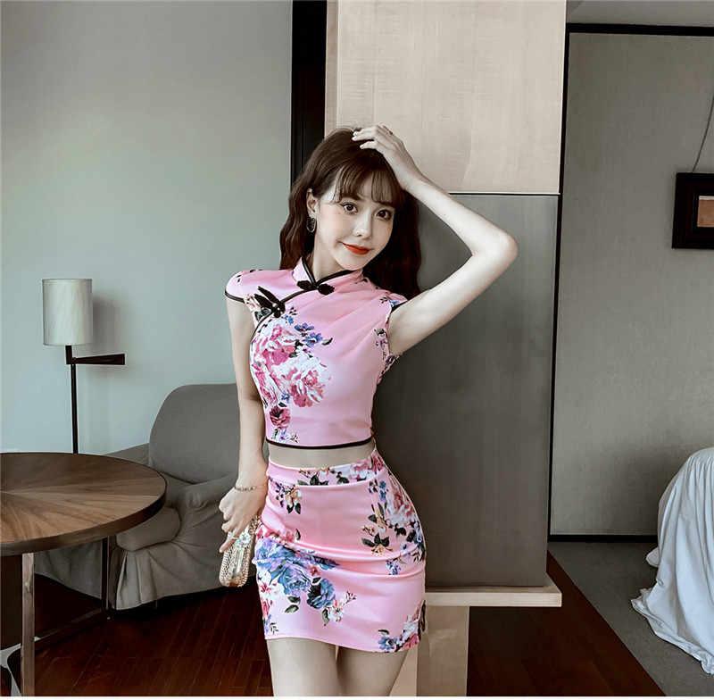 Sexy femmes ensembles ancre blogueur Sexy discothèque haut court + mince moulante jupe costume 2 pièces imprimé fleuri Mini Cheongsam robe