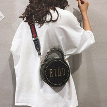 One-shoulder female bag new fashion spring and summer small round bag rivet broadband oblique Korean version of the diagonal lace embroidered small round bag 2019 new korean fashion casual women s bag round tassel bag shoulder diagonal tote bag