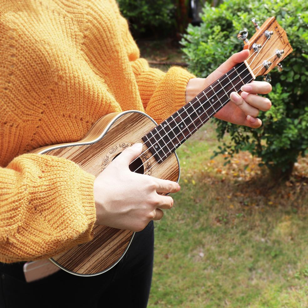 Купить с кэшбэком 21 Inch High Quality Soprano Ukulele Zebra Wood 15 Frets Four Strings Guitar + Bag + Tuner + Strings + Strap + Cloth
