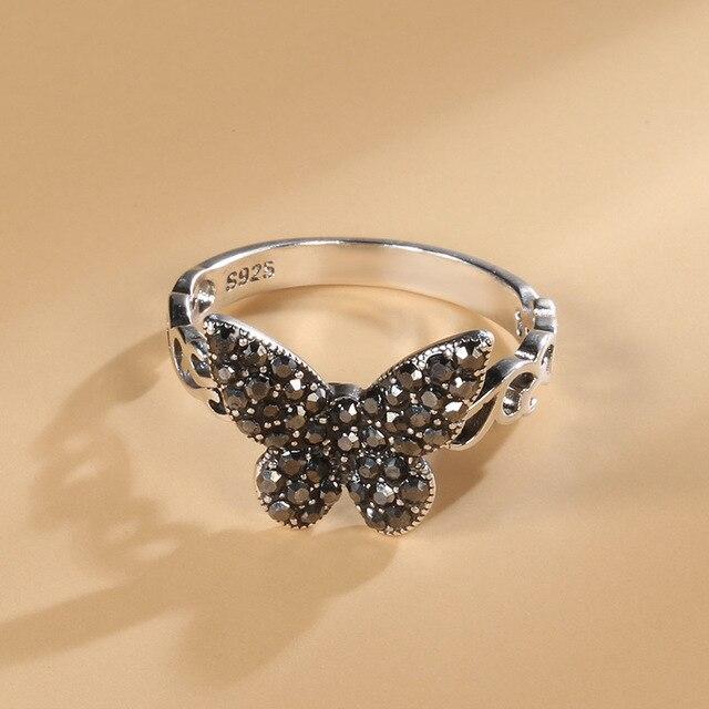 Фото винтажное тибетское серебряное черное кольцо с бабочкой из фианита цена