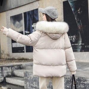 Image 2 - Abrigo de piel grande con cuello para mujer, chaquetas de otoño e invierno para mujer, Parkas de plumas cálidas, chaqueta acolchada de algodón, abrigo con capucha para mujer