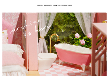 this shows the bathroom of the pink doll house
