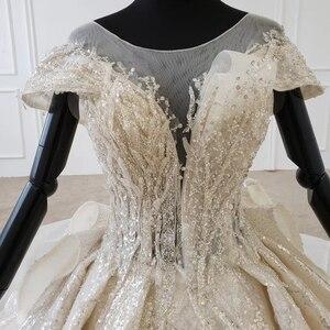 Image 5 - HTL1137 błyszcząca suknia ślubna nakryty rękawem o neck zasznurować gorset suknie ślubne wzburzyć pociąg ins gorąca sprzedaż świecący vestidos novia