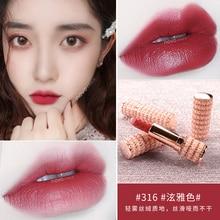 Novo moisturizing lipstick with white gold pearl apperance tomato red orange wat