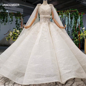 Image 1 - HTL973 ball gown wedding dresses detachable sleeve shawl o neck bow belt bead wedding gowns with tail glitter robe mariage femme