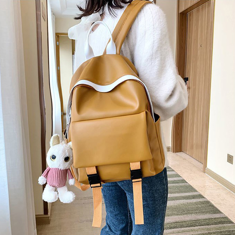 Luxury Female Bag 2020 New Backpack Female Student School Bag Waterproof Soft Leather Bag Bear Pendant Casual Travel Bag Mochila