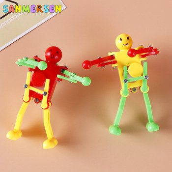 1 unidad de Robot bailarín juguetes con cuerda, juguetes para niños, lindos y divertidos juguetes creativos de plástico, Robot bailarín mecánico, regalos para el desarrollo del bebé