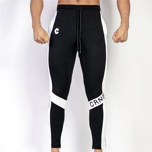 Image 3 - جديد الرجال ركض سراويل تقليدية اللياقة البدنية الرجال رياضية بنطلون قيعان نحيل Sweatpants بنطلون أسود صالات رياضية بنطلون ركض