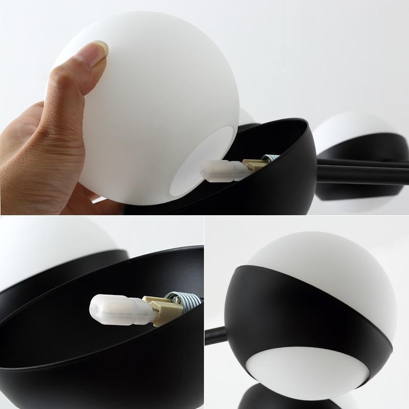 Купить с кэшбэком Postmodern luxury living room pendant lamp designer creative personality villa restaurant glass ball adjustable G9pendant lights